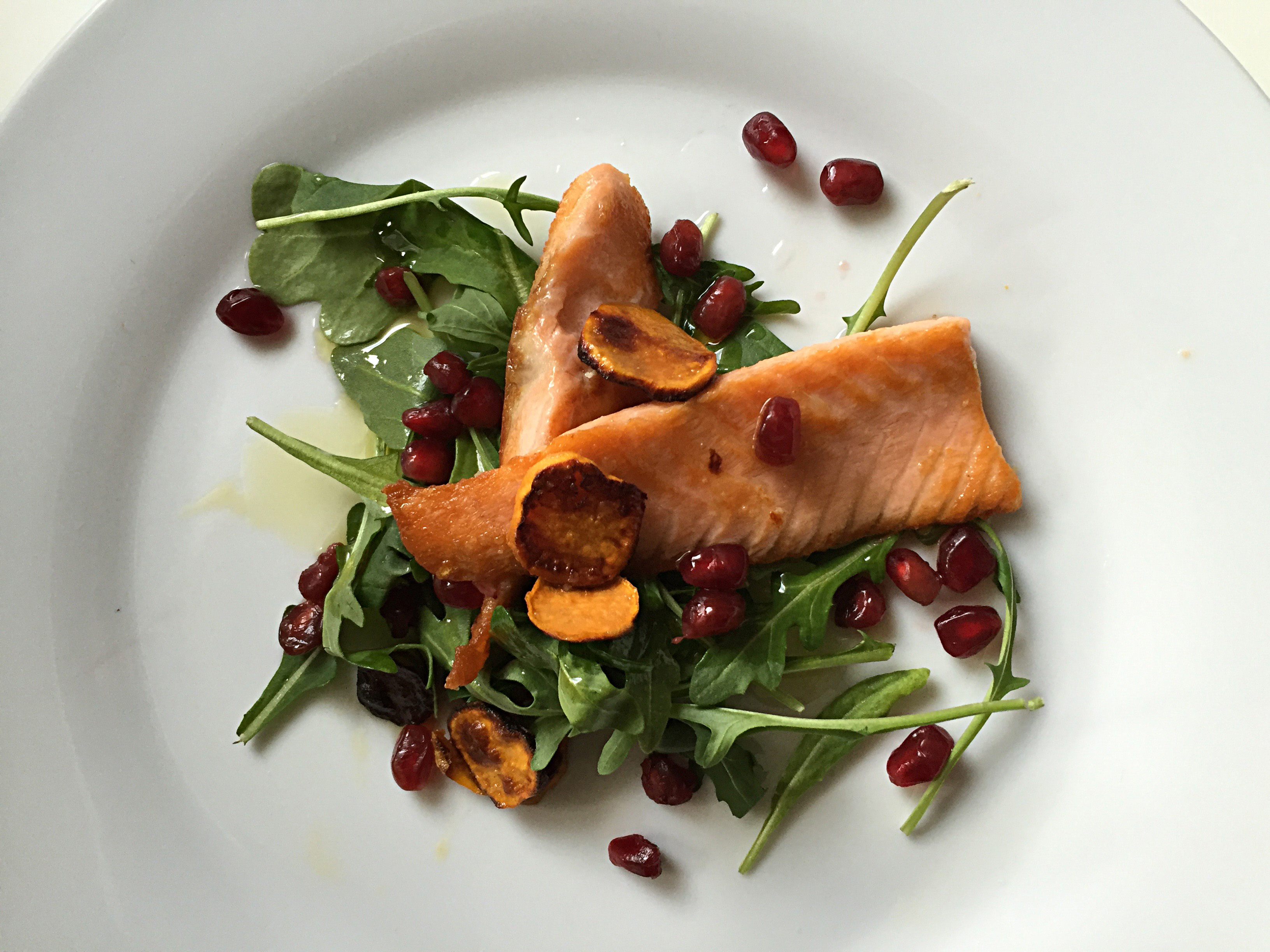 Salt-Seared Salmon Belly with Sweet Potato Chips, Arugula & Pomegranate Seeds