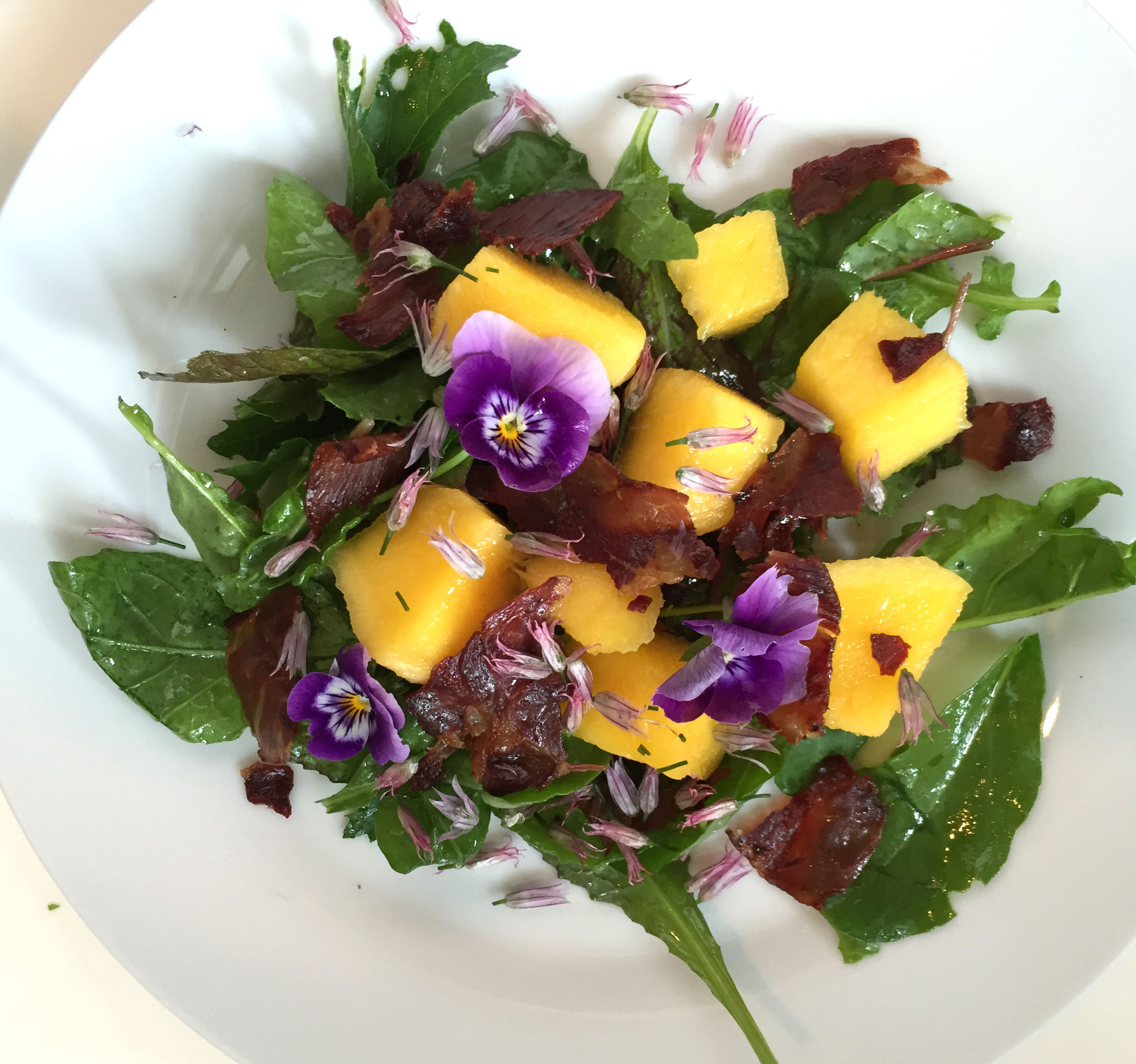Salad of Mango, Arugula, Crispy Coppa, Pansies & Chives